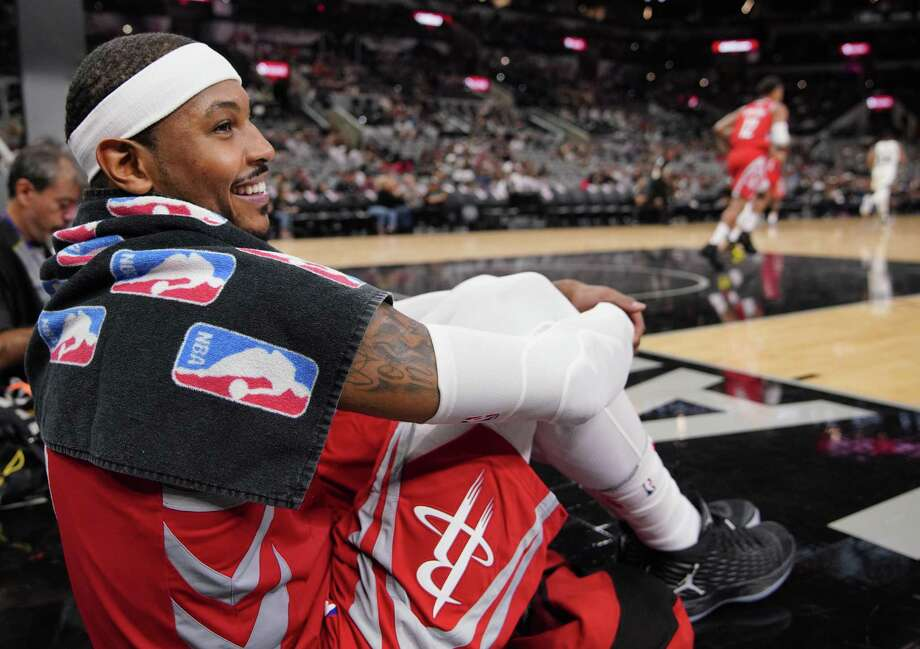 Houston Rockets' Carmelo Anthony watches play from the baseline during the second half of an NBA preseason basketball game against the San Antonio Spurs, Sunday, Oct. 7, 2018, in San Antonio. (AP Photo/Darren Abate) Photo: Darren Abate, FRE / Associated Press / FR115 AP