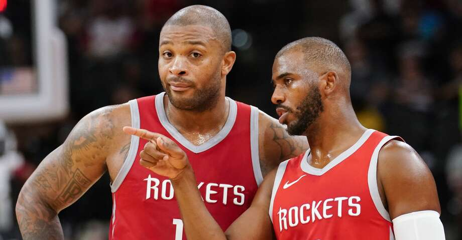 Houston Rockets' Chris Paul (3) and P.J. Tucker talk during the second half of an NBA preseason basketball game against the San Antonio Spurs, Sunday, Oct. 7, 2018, in San Antonio. (AP Photo/Darren Abate) Photo: Darren Abate/Associated Press