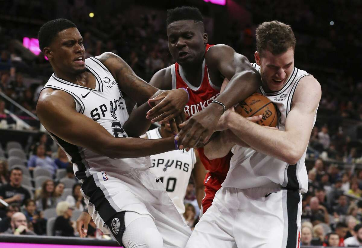 Houston Rockets?' Clint Capela fights for a rebound against San Antonio Spurs?' Rudy Gay, left, and Jakob Poeltl during the second half at the AT&T Center, Sunday, Oct. 7, 2018. The Spurs lost 108-93.