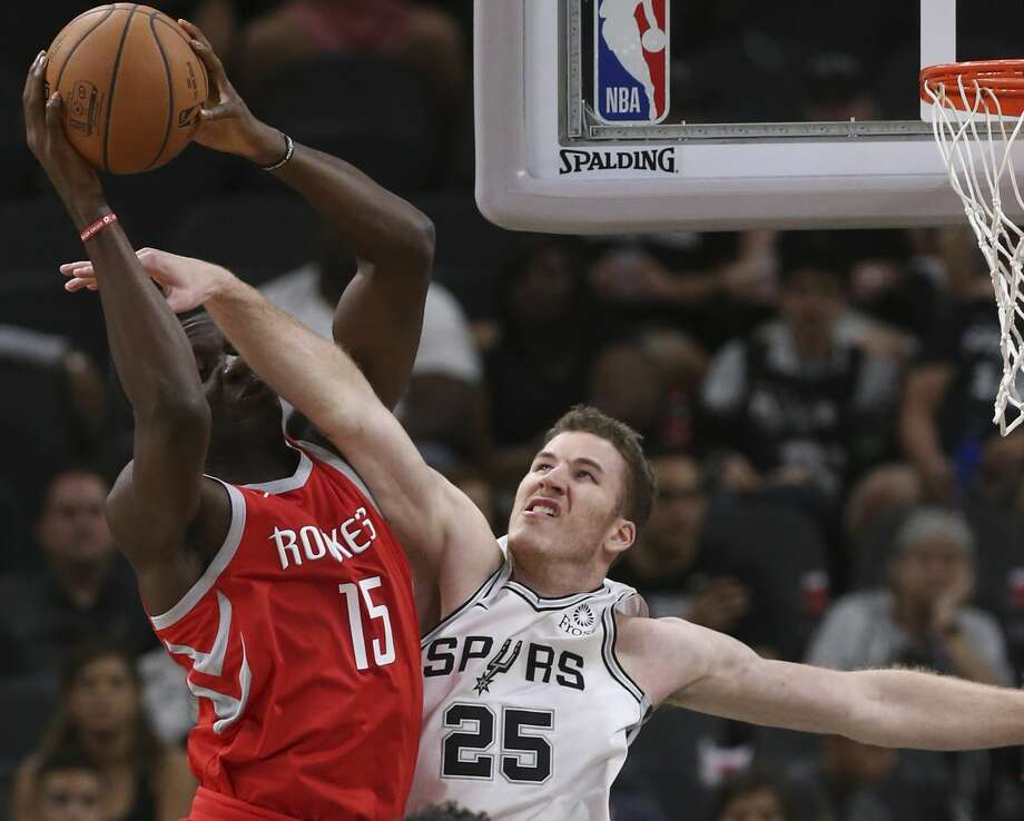 San Antonio Spurs' Jakob Poeltl attempts to block Houston Rockets' Clint Capela during the first half at the AT&T Center, Sunday, Oct. 7, 2018. Photo: JERRY LARA/San Antonio Express-News