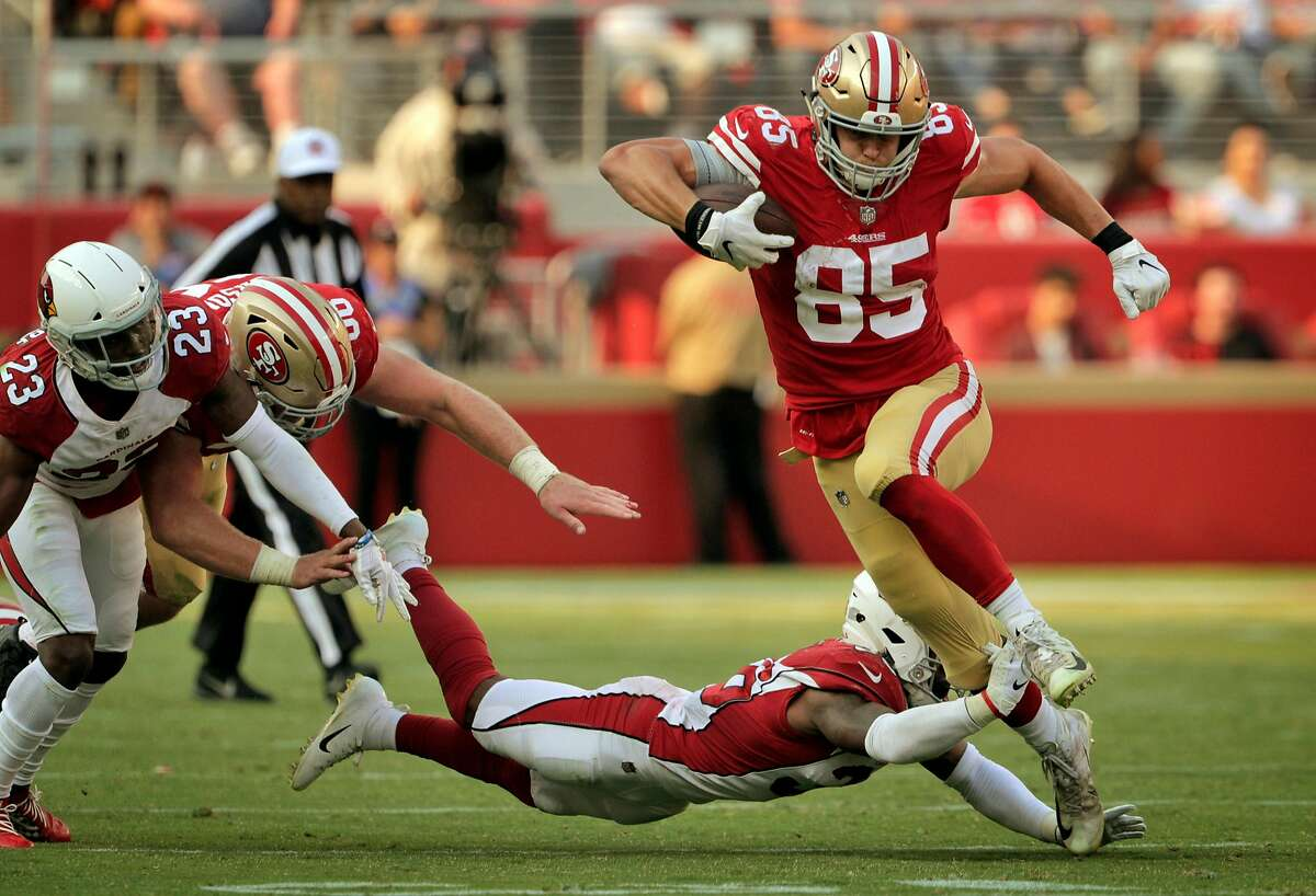 George Kittle (85) evades a tackle by Budda Baker (36) in the fourth quarter and ran for a first down after the catch as the San Francisco 49ers played the Arizona Cardinals at Levi's Stadium in Santa Clara, Calif., on Sunday, October 7, 2018.