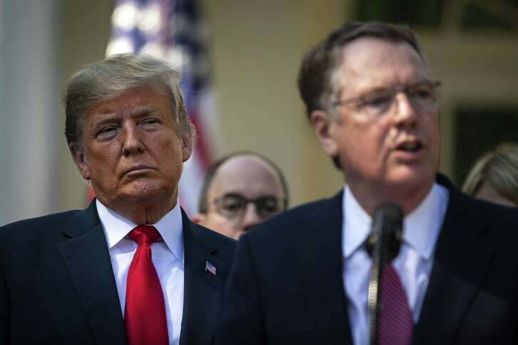 President Donald Trump listens as Robert Lighthizer, the U.S. trade representative, speaks about the revised North American Free Trade Agreement at the White House in Washington, Oct. 1, 2018.