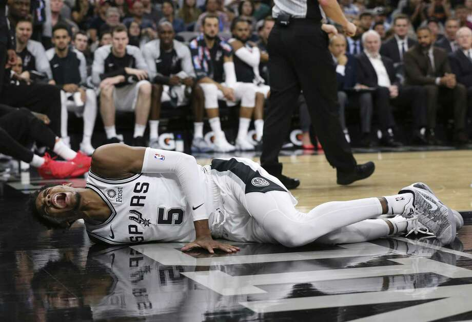 San Antonio Spurs' Dejounte Murray reacts after getting injured during the first half against the Houston Rockets at the AT&T Center, Sunday, Oct. 7, 2018. Photo: JERRY LARA / San Antonio Express-News / © 2018 San Antonio Express-News