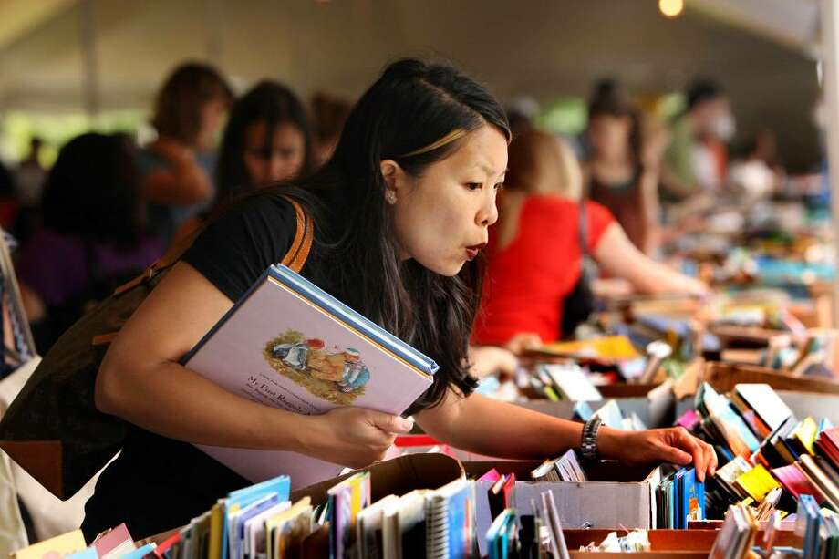 Jennifer Yee , of Forest Hills, NY,  searches for children's books at the 49 annual Pequot Library book sale in July 2009. Photo: B.K. Angeletti / Connecticut Post Freelance