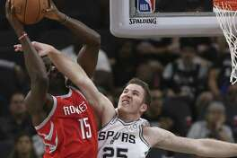 San Antonio Spurs?' Jakob Poeltl attempts to block Houston Rockets?' Clint Capela during the first half at the AT&T Center, Sunday, Oct. 7, 2018.