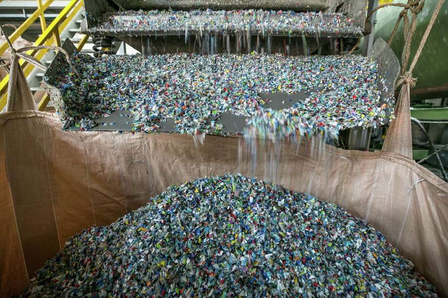 Plastic flakes drop into a sack at a Junyoung Industrial facility in Gimpo, South Korea, in April. Photo: Bloomberg Photo By Jean Chung / Bloomberg