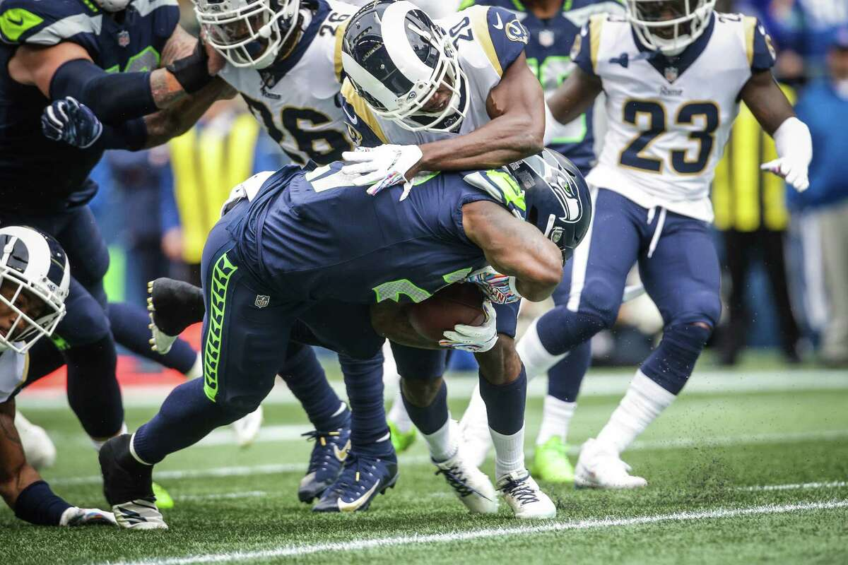 Seahawks running back Mike Davis scores a touchdown during the first half of the Seahawks game against the Los Angeles Rams, Sunday, Oct. 7, 2018 at CenturyLink Field.