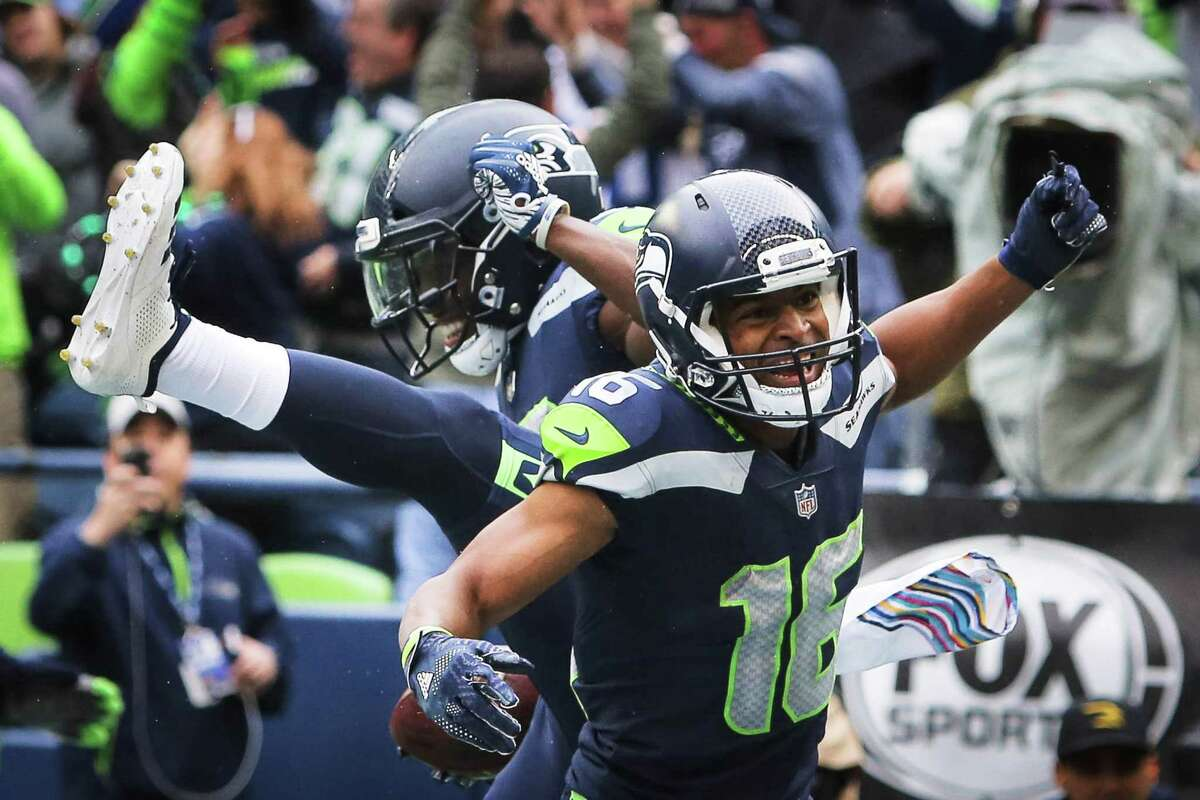 Seahawks wide receiver Tyler Lockett and wide receiver David Moore celebrate Moore's touchdown during the second half of the Seahawks game against the Los Angeles Rams, Sunday, Oct. 7, 2018 at CenturyLink Field. The Rams won 33-31.