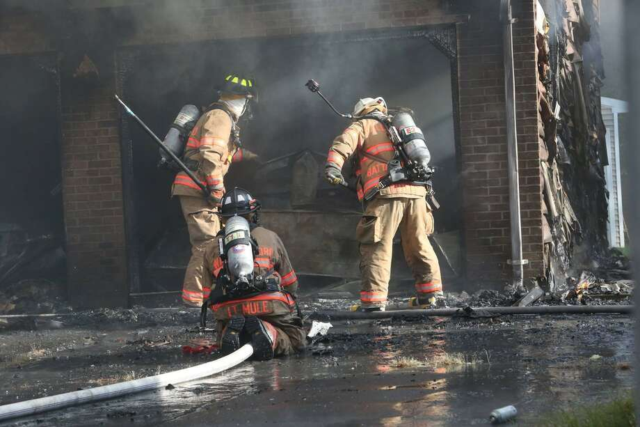 Two firefighters were injured in a house fire at 427 N. Elm St. in Wallingford on Sunday. Photo: Ray Ross / Courtesy Of Wallingford Fire Department