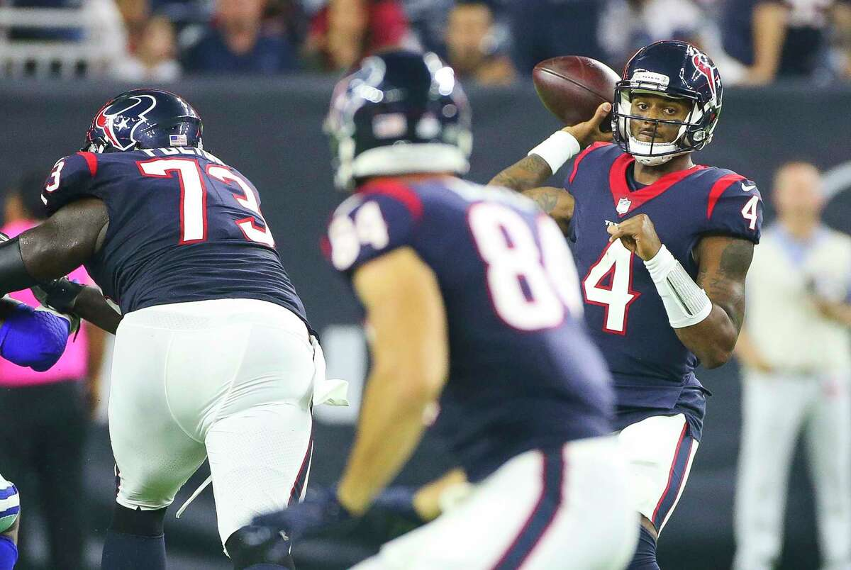Houston Texans quarterback Deshaun Watson (4) looks at Houston Texans tight end Ryan Griffin (84) as he prepares to pass during the second quarter of an NFL football game at NRG Stadium on Sunday, Oct. 7, 2018, in Houston.