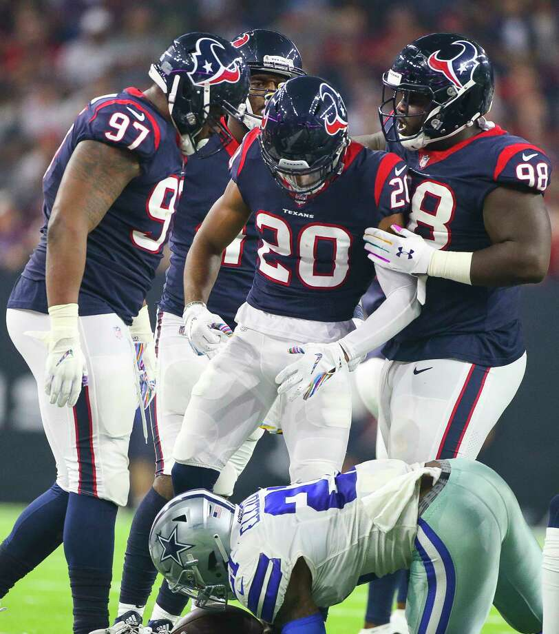 Houston Texans defensive back Justin Reid (20) celebrates with the rest of the Texans defense over Dallas Cowboys running back Ezekiel Elliott (21) during the second quarter of an NFL football game at NRG Stadium on Sunday, Oct. 7, 2018, in Houston. Photo: Elizabeth Conley, Staff Photographer / © 2018 Houston Chronicle