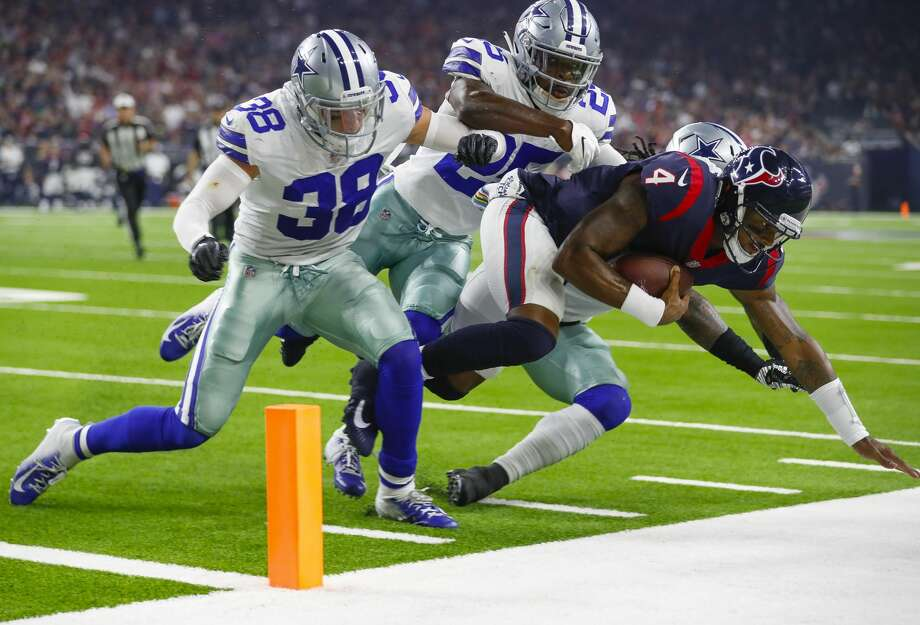 Texans quarterback Deshaun Watson was pummeled at times Sunday night by the Cowboys defense as he left the pocket. Photo: Brett Coomer/Staff Photographer