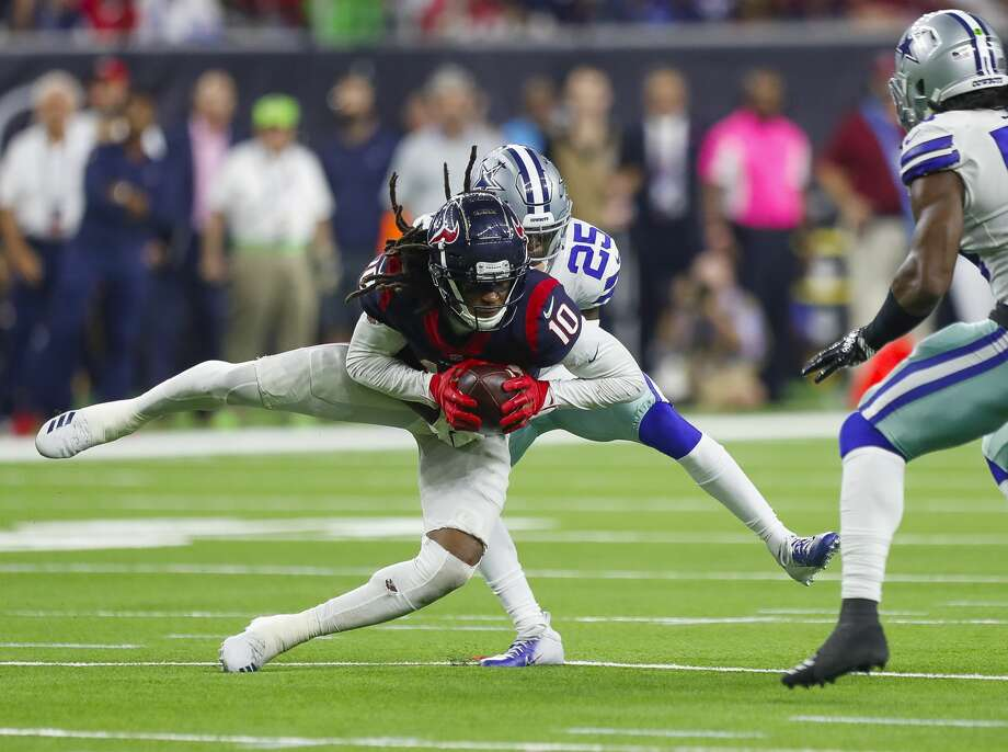 Houston Texans wide receiver DeAndre Hopkins (10) pulls down a reception through Dallas Cowboys free safety Xavier Woods (25) during the fourth quarter of an NFL football game at NRG Stadium on Sunday, Oct. 7, 2018, in Houston. Photo: Brett Coomer/Staff Photographer