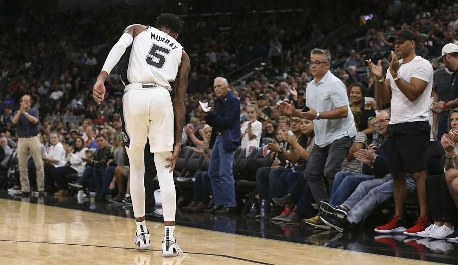 San Antonio Spurs' Dejounte Murray walks off an injury during the first half against the Houston Rockets at the AT&T Center, Sunday, Oct. 7, 2018. Photo: JERRY LARA, San Antonio Express-News