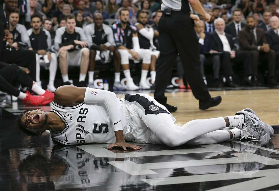 San Antonio Spurs� Dejounte Murray reacts after getting injured during the first half against the Houston Rockets at the AT&T Center, Sunday, Oct. 7, 2018. Photo: JERRY LARA, San Antonio Express-News