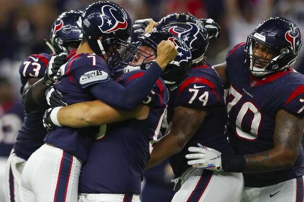 Houston Texans center Greg Mancz (65) lifts Houston Texans kicker Ka'imi Fairbairn (7) into the air after Fairbairn hit a game winning field goal during overtime of an NFL football game at NRG Stadium on Sunday, Oct. 7, 2018, in Houston.