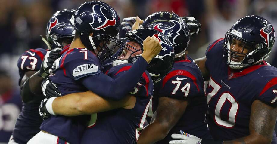 Houston Texans center Greg Mancz (65) lifts Houston Texans kicker Ka'imi Fairbairn (7) into the air after Fairbairn hit a game winning field goal during overtime of an NFL football game at NRG Stadium on Sunday, Oct. 7, 2018, in Houston. Photo: Brett Coomer/Staff Photographer