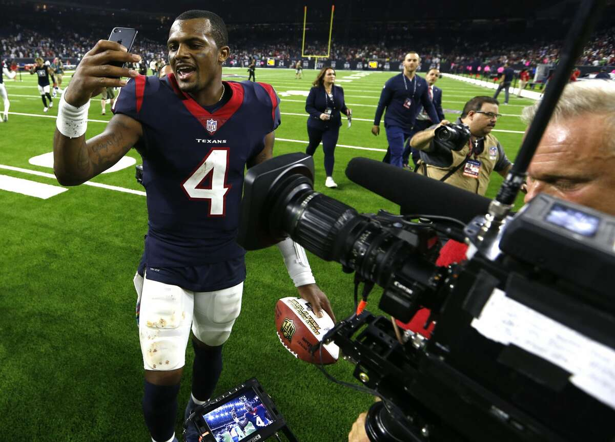 Houston Texans quarterback Deshaun Watson (4) records a video on a phone as he celebrates the Texans 19-16 overtime win over the Dallas Cowboysa at NRG Stadium on Sunday, Oct. 7, 2018, in Houston.
