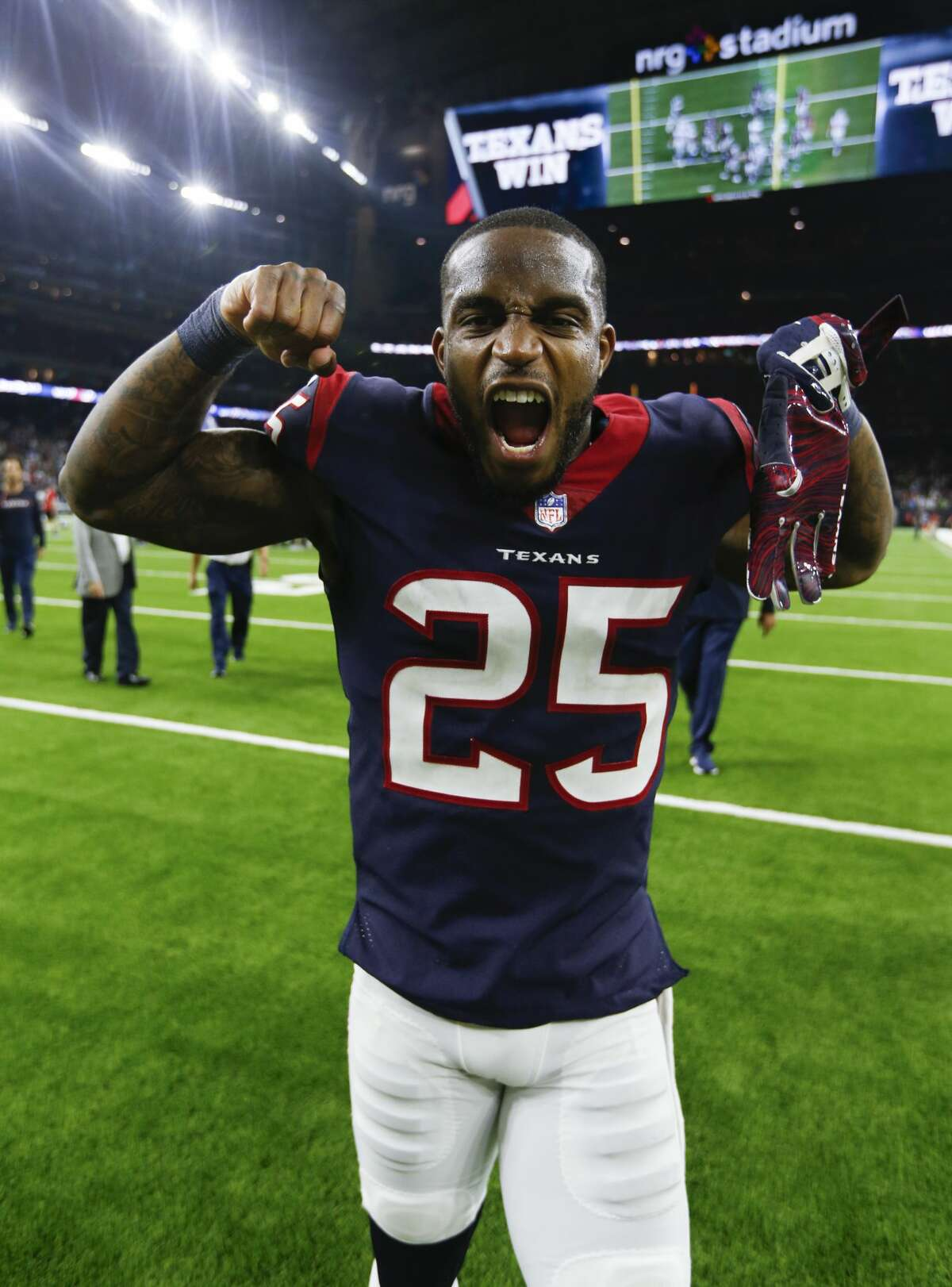 Houston Texans strong safety Kareem Jackson (25) celebrates as he runs off the field after the Texans beat the Dallas Cowboys 19-16 in overtime of an NFL football game at NRG Stadium on Sunday, Oct. 7, 2018, in Houston.