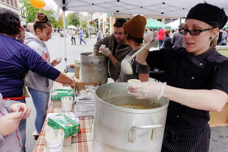Bountiful Bread chef, Riyonna Caswell, foreground right, and Bountiful Bread employees, Nicole Hooker, center, and Tony Benamati, serve smoky seafood chowder at the 12th Annual Troy ChowderFest on Sunday, Oct. 7, 2018, in Troy, N.Y.  (Paul Buckowski/Times Union) Photo: Paul Buckowski / (Paul Buckowski/Times Union)