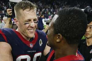 Houston Texans defensive end J.J. Watt (99) and quarterback Deshaun Watson (4) embrace after the Texans beat the Dallas Cowboys 19-16 in overtime of an NFL football game at NRG Stadium on Sunday, Oct. 7, 2018, in Houston.