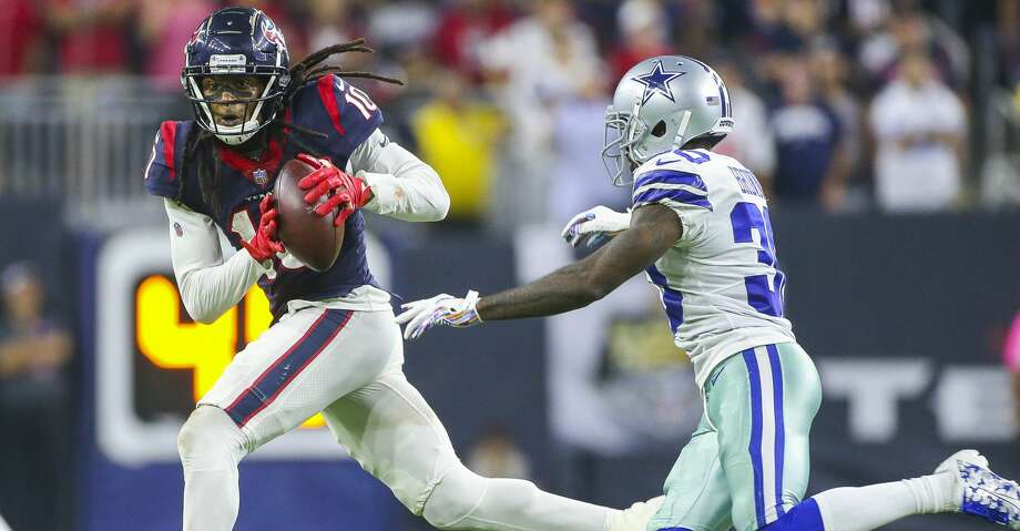 Houston Texans wide receiver DeAndre Hopkins (10) makes a long reception to put the Texans in field goal range during overtime of an NFL football game at NRG Stadium on Sunday, Oct. 7, 2018, in Houston. Photo: Elizabeth Conley/Staff Photographer