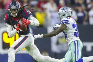 Houston Texans wide receiver DeAndre Hopkins (10) makes a long reception to put the Texans in field goal range during overtime of an NFL football game at NRG Stadium on Sunday, Oct. 7, 2018, in Houston.