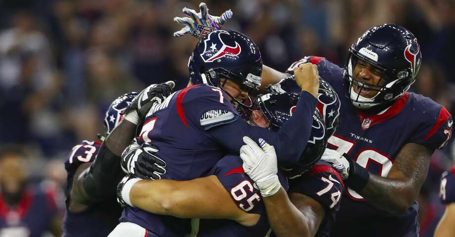 PHOTOS: Texans vs. Cowboys Houston Texans center Greg Mancz (65) lifts Houston Texans kicker Ka'imi Fairbairn (7) into the air after Fairbairn hit a game winning field goal during overtime of an NFL football game at NRG Stadium on Sunday, Oct. 7, 2018, in Houston. Browse through the photos to see action from the Texans' game against the Cowboys. Photo: Brett Coomer/Staff Photographer
