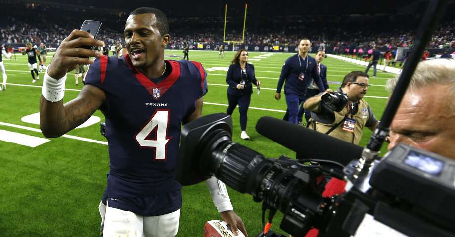 Here's Deshaun Watson using his phone in happier days, after the Texans beat the Cowboys in 2018 at NRG Stadium. Photo: Brett Coomer/Staff Photographer