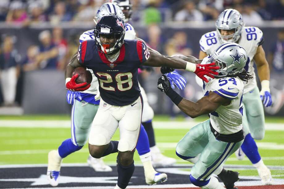 Texans running back Alfred Blue caught a career-high eight passes for 73 yards during Sunday's win over the Cowboys. Photo: Elizabeth Conley/Staff Photographer