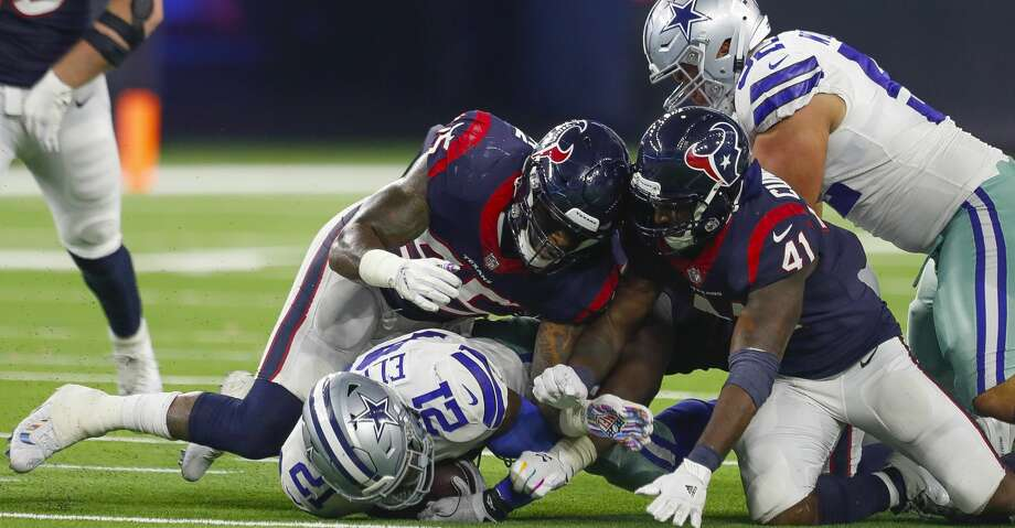 PHOTOS: Texans vs. Cowboys Houston Texans linebacker Benardrick McKinney (55) and linebacker Zach Cunningham (41) tackle Dallas Cowboys running back Ezekiel Elliott (21) during the third quarter of an NFL football game at NRG Stadium on Sunday, Oct. 7, 2018, in Houston. Browse through the photos to see action from the Texans' game against the Cowboys. Photo: Brett Coomer/Staff Photographer
