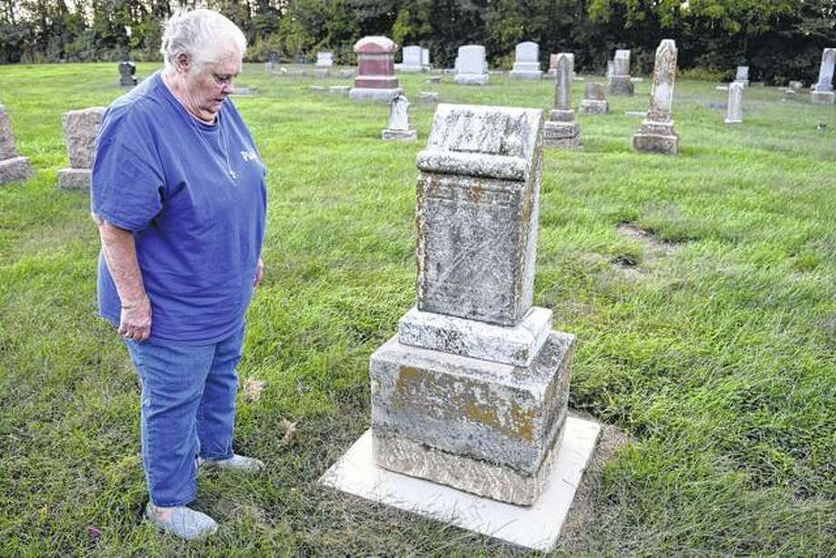 Sandy Winner of Jacksonville looks at one of the recently restored gravestones at Union Baptist Cemetery near Pisgah. Winner and others are raising money to preserve the old cemetery. Photo: Greg Olson | Journal-Courier