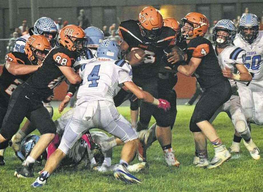 Triopia's defense bottles up Beardstown's Pascal Guilavogui during a high school football game Friday night in Beardstown. Photo: Audrey Clayton | Journal-Courier