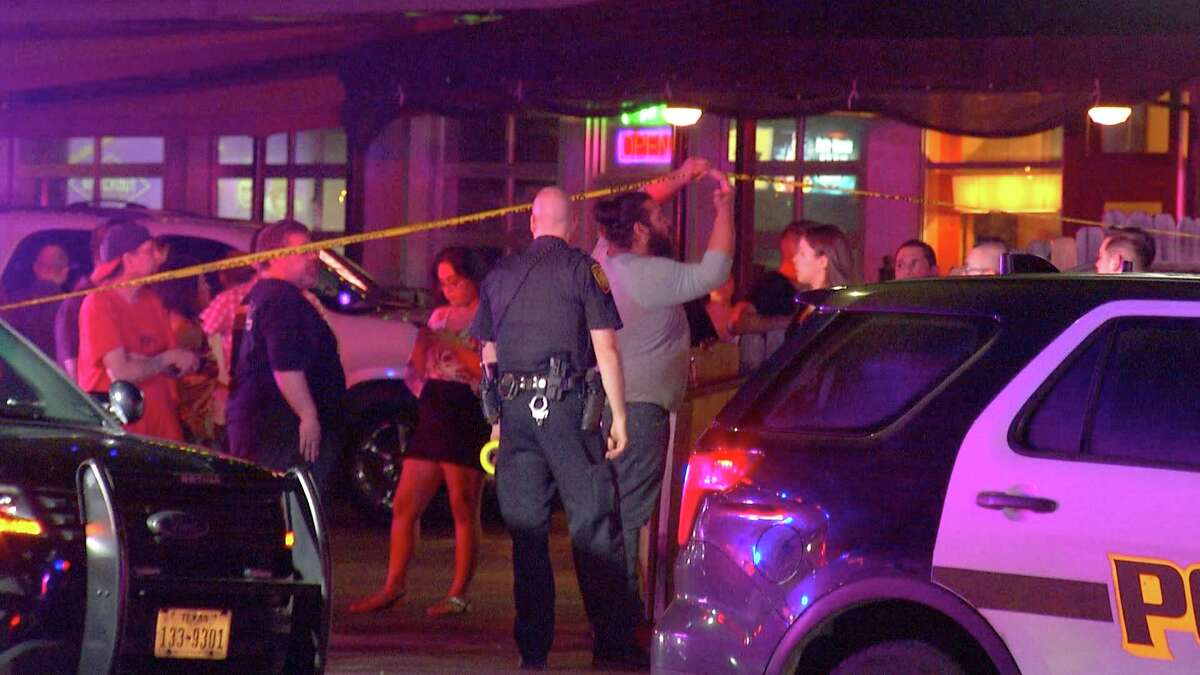 The shooting was prompted by a fight at about 12:20 a.m. outside the Pegasus bar in the 1400 block of North Main Avenue. Two suspects involved in the fight got into a red Nissan sedan, and opened fire on a crowd of people as they sped away.