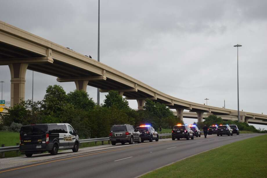 major highway interchange reopens after man jumps from overpass