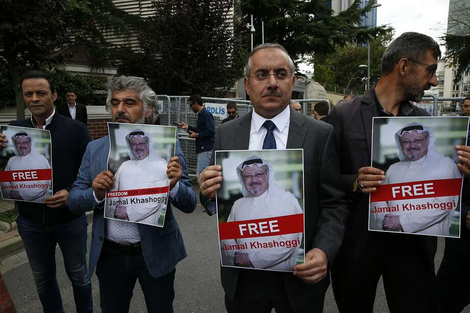 Members of a journalists' association hold pictures of missing writer Jamal Khashoggi outside the Saudi Consulate in Istanbul. Turkish officials say Khashoggi was killed in the facility. Photo: Lefteris Pitarakis / Associated Press
