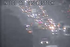 A severe traffic alert was issued early Monday morning for Highway 101  just north of Candlestick in San Francisco after a collision involving  two vehicles caused one of them to overturn and block the right lanes,  officials said.