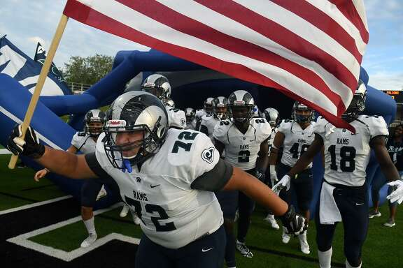 Cy Ridge senior offensive lineman Rafael Soltero (72) leads his team onto the field before the start of the Ram's District 17-6A matchup with Jersey Village at Pridgeon Stadium on Sept. 13, 2018.