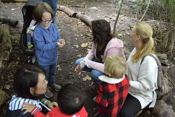 Crosby Powers, 5, of Darien, at left, shows a worm he found to the group on the Reconnecting with Nature walk at the Darien Nature Center on Saturday, Oct. 6, 2018, in Darien, Conn.