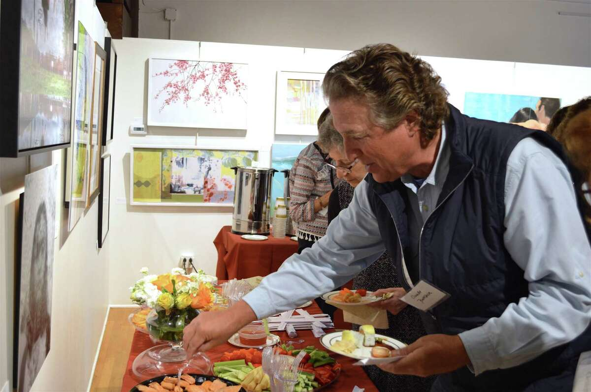 Claude Bernstein of New Canaan tries some sushi at the United Jewish Federation of Greater Stamford, New Canaan and Darien's Major Donor Reception at the Carriage Barn Art Center, Sunday, Oct. 7, 2018, in New Canaan, Conn.
