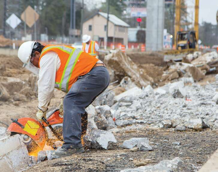 Construction crews work on the Grand Parkway Wednesday in Spring. Completion for the 38-mile project is set for late 2015 and will run through Montgomery and Harris counties.