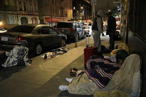 Homeless people on the 300 block of Hyde Street in San Francisco, Sept. 14, 2018. The city's new mayor has made cleaner streets a top priority. Residents say it will take much more than a broom to do it. (Jim Wilson/The New York Times)