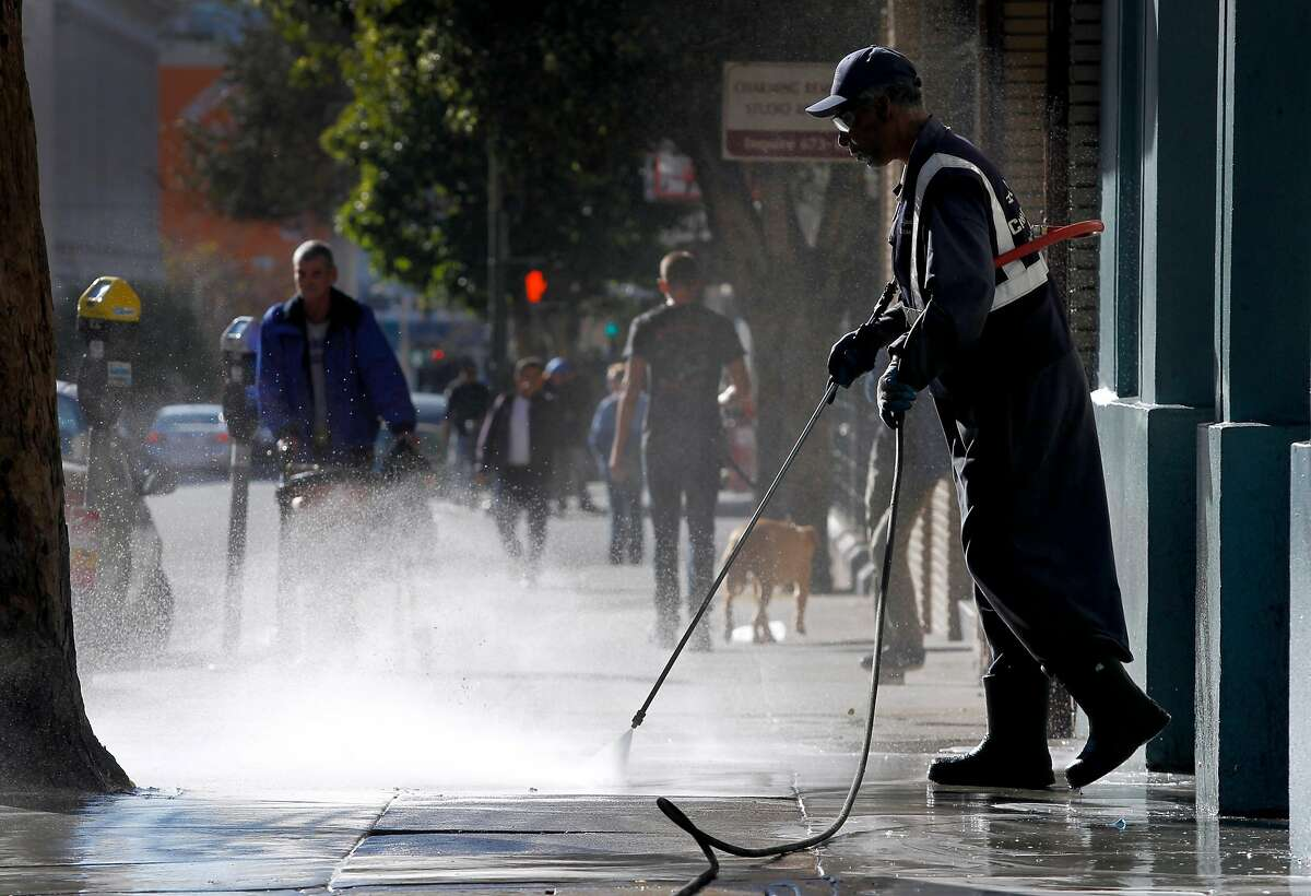 Fallery Gourrier, of the Clean City team in the Tenderloin, power washes the sidewalk on Hyde Street in San Francisco, Calif. on Saturday, Jan. 31, 2015. Volunteers fanned out across the Tenderloin and South of Market to clean up streets and sidewalks for the 15th year of the Department of Public Works' Community Clean Team effort.