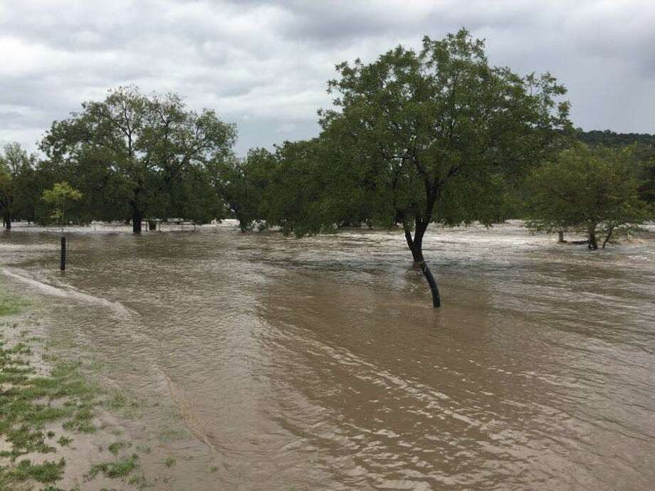 First responders were kept busy with multiple rescue calls after heavy rain flooded the Llano River in Junction. Photo: Texas Game Wardens
