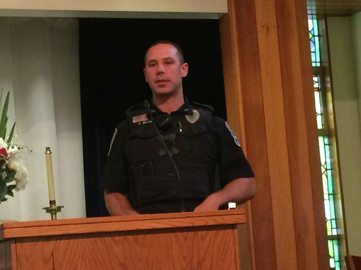 Ansonia Police Officer Brendon Nelson thanks the First Baptist Church for organizing Main Street restaurants into a Tip-A-Cop program to raise money for police protective gear.