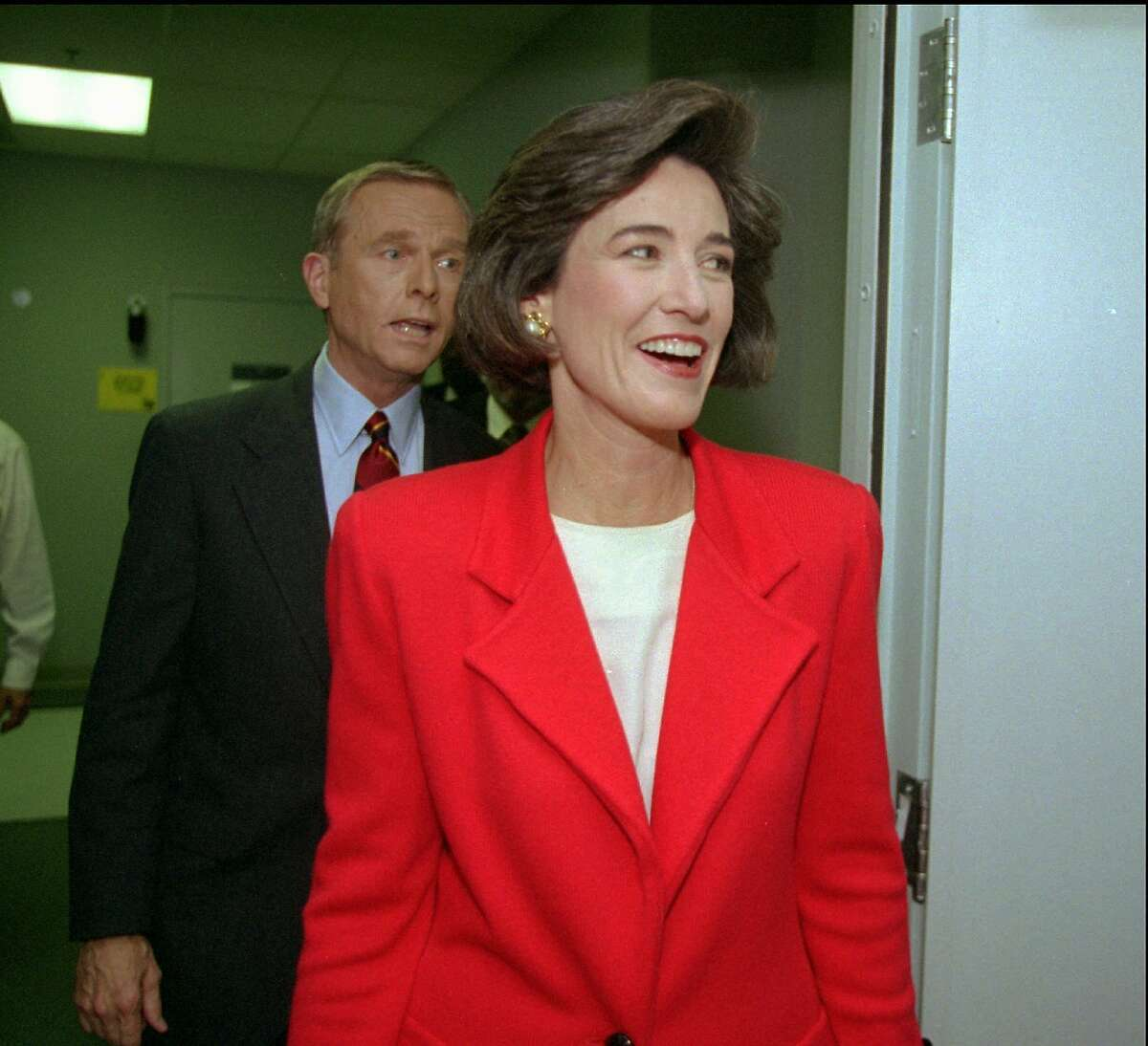 Democratic gubernatorial candidate Kathleen Brown, right, and Republican Gov. Pete Wilson leave a Sacramento, Calif., television studio Friday, Oct. 14, 1994, after finishing their only planned debate. (AP Photo/George Nikitin)