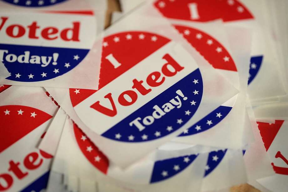 DES MOINES, IA - OCTOBER 08:  Stickers are made available to voters who cast a ballot in the midterm elections at the Polk County Election Office on October 8, 2018 in Des Moines, Iowa. Today was the first day of early voting in the state.  (Photo by Scott Olson/Getty Images) Photo: Scott Olson, Getty Images