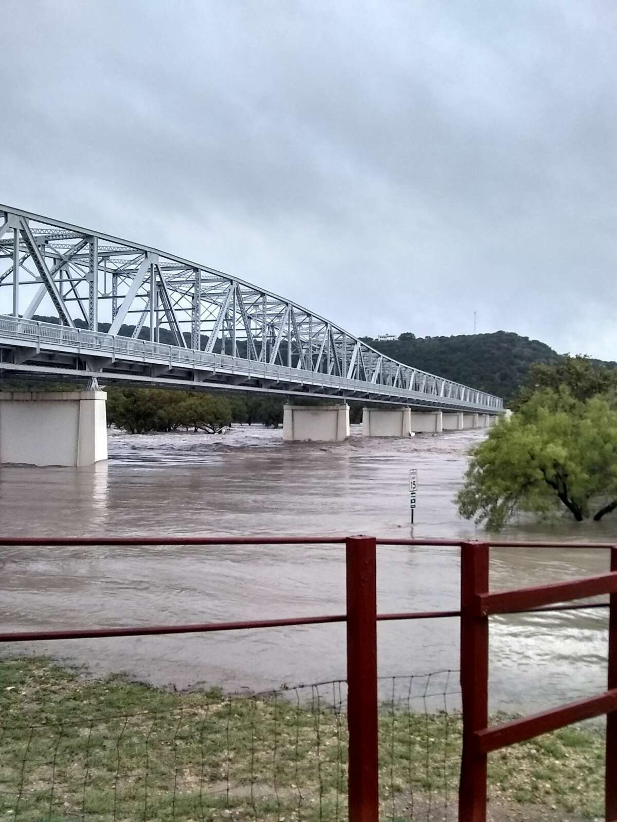The South Llano River reached 31 feet in Junction, Texas, Monday morning, causing the river to overflow its banks and essentially drowning a nearby RV Park.