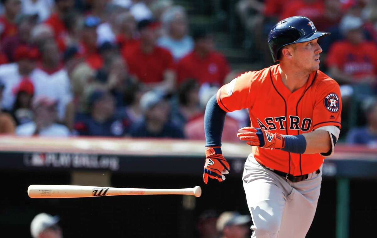 Houston Astros third baseman Alex Bregman tosses his bat after hitting a double off the wall during the first inning of Game 3 of the American League Division Series at Progressive Field on Monday, Oct. 8, 2018, in Cleveland.