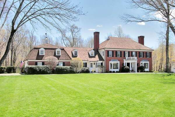The brick and clapboard colonial house at 165 High Point Lane sits on a two-acre level property in the Greenfield Hill section of Fairfield.